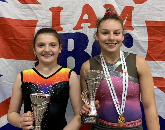 Emily Ebbage, left, and Alisha Evanson were victors in their respective categories while representing Northwich-based Cheshire Gymnastics at the English Silver Tumbling Championships in Telford