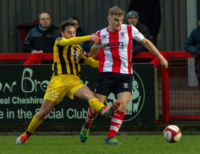 Josh Wardle, pictured in action during a Northern Premier League encounter with Scarborough Athletic last season, has agreed terms to stay with Witton Albion for a second year. Picture: Karl Brooks Photography