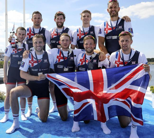 Tom Ford, second from right on the front row, and his Great Britain men's eight teammates celebrate on the podium after winning a silver medal at last month's World Cup in Poland. Picture: Nick Middleton/British Rowing