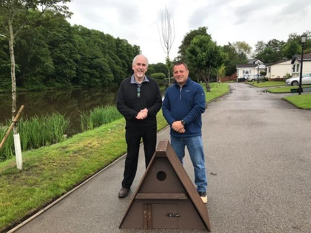 John Mycock, chairman of the Mid Cheshire Barn Owl Conservation Group, and one of Riverside Park's owners Darren Jones with the birdbox