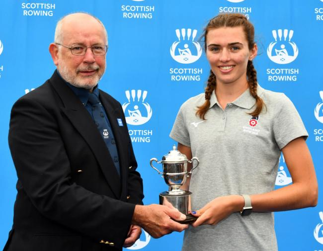 Northwich Rowing Club member Ellie Cushen, right, is presented with the junior women's team title in her role as England captain at the Home International Regatta in Scotland last weekend. Picture: @HIR2019