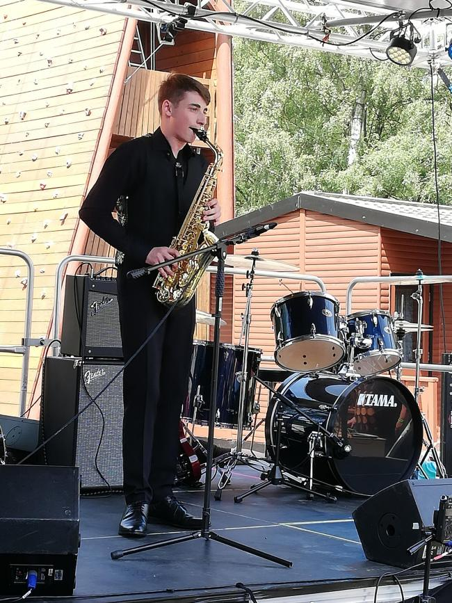 André Adams, who has autism and plays the saxophone and drums , performing at Petty Pool Music Fest