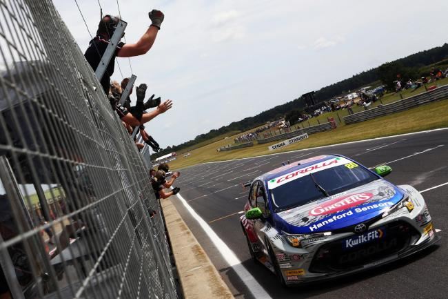 Tom Ingram takes the acclaim from Speedworks' pit crew after crossing the line first behind the wheel of his Team Toyota GB Corolla in a British Touring Car Championship race at Snetterton. Picture: Matt Sayle Photography
