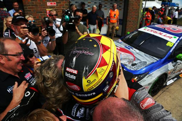 Northwich Guardian: Tom Ingram celebrates with friends and family following his victory in a Speedworks Motorsport-built Toyota Corolla during the British Touring Car Championship's latest round at Snetterton on Sunday. Picture: Matt Sayle Photography