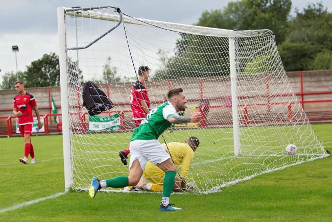 Matty Clarke runs to celebrate with Northwich Victoria's supporters after scoring a second goal during their FA Cup extra preliminary round encounter with Silsden on Saturday. Picture: Angela Buckley/Truly Photogenic