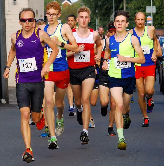 Alex Doyle, second from left, and Raif Serif (wearing 223) in action for Vale Royal Athletics Club at the start of last week's Pie and Peas Five. Picture: Bryan Dale/Race Photos