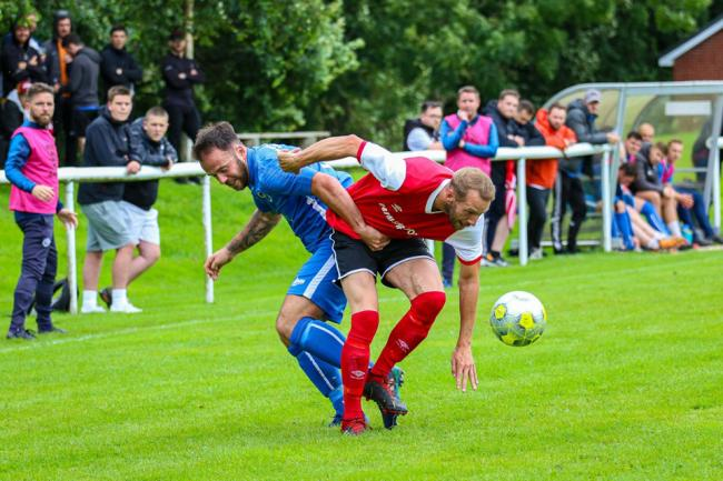Knutsford returned from a short journey to Lostock Gralam with a share of the spoils after their hosts scored late in a Cheshire League Premier Division encounter on Saturday