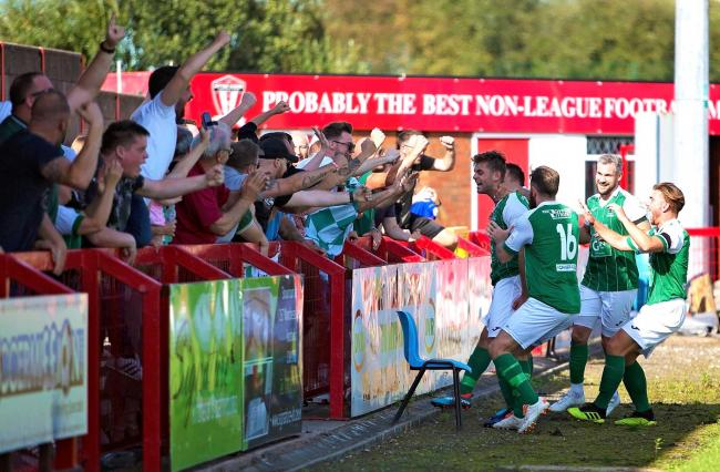 Tom Kilifin – here celebrating his winner against Prescot Cables – is one of three former Lancaster City players in the Northwich Victoria squad. Ryan Winder, far right, is another. Picture: Angela Buckley