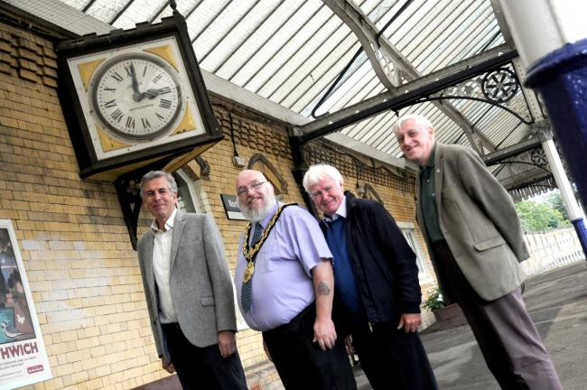 Simon Barber and John Hulme (second right) of MCRUA with town mayor Cllr Kevin Rimmer and Mike Lenz of 8E Railway Association