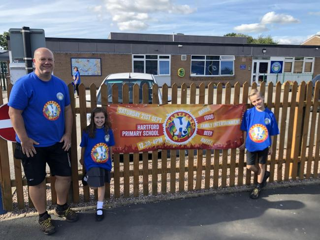 Pupils Sydney Smith and Max Watson and school caretaker  Matt Harris are looking forward to the first Hartfest at Hartford Primary School on Saturday, September 21.