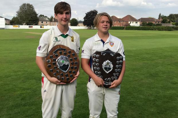 Weaverham Cricket Club's under 13s captain Archie Lightfoot, left, and under 15s skipper Calum Bridge with their trophies