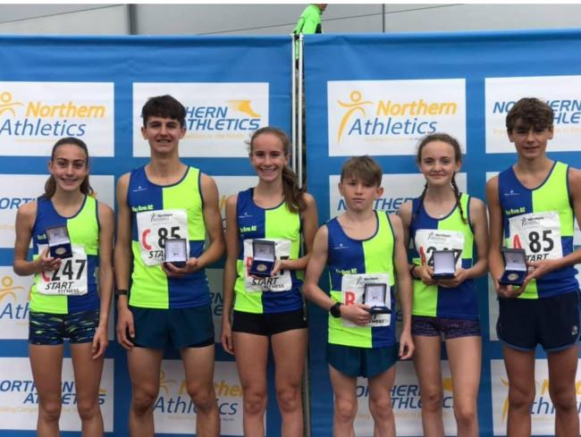 From left, Holly Weedall, Patrick Griffith, Grace Roberts, Jake Wilson, Hope Smith and Dylan Carney with their Northern Road Relays medals