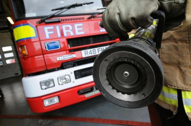 Firefighters called after hay and manure fire spreads to nearby trees