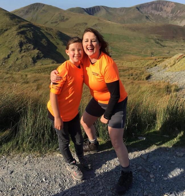 Ellie Dickens, 11, climbed Mount Snowdon with Lisa Simkins and 116 other fundraisers including staff, patients and friends
