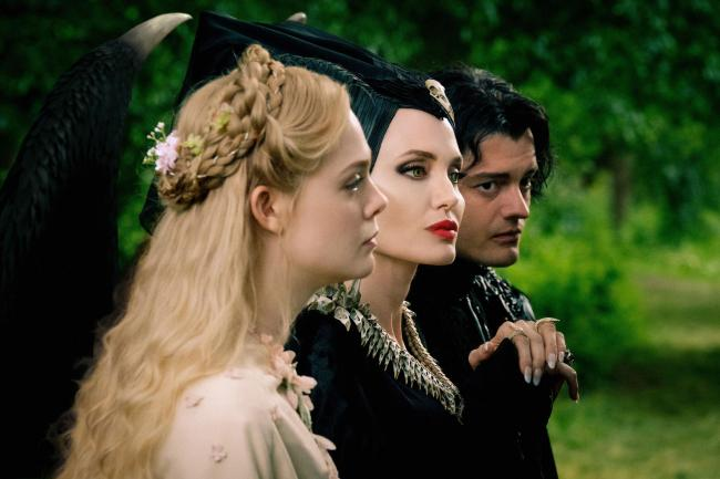 Elle Fanning as Princess Aurora, Angelina Jolie as Maleficent and Sam Riley as Diaval