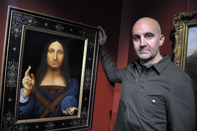 Lee Trantum with his painting of Leonardo da Vinco's Salvator Mundi 						                       Picture: Mike Boden