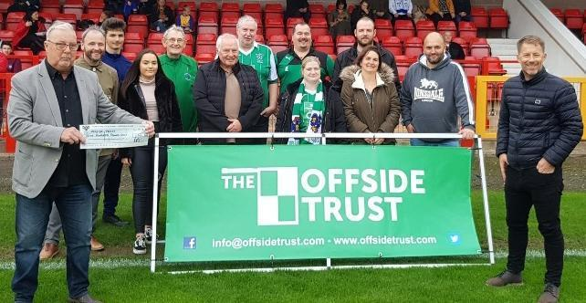 Kenny Jones, left, and another fans' favourite Steve Walters, Steve Walters, a director of the Offside Trust, far right, with Vics supporters who took part in a sponsored walk up Snowdon last year to raise money for the charity