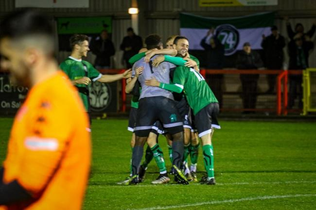 Tony Aghayere is mobbed by his teammates after the decisive save during the penalty shootout against Witton Albion in the Cheshire Senior Cup last month. Picture: Karl Brooks Photography