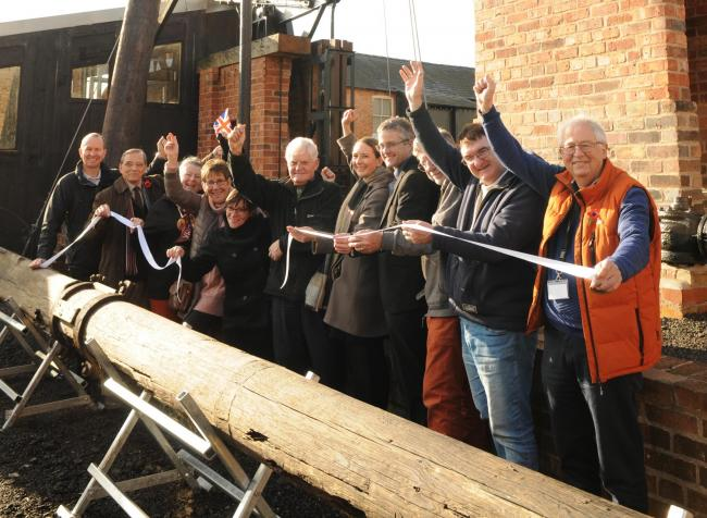 Trustee Juan Cunliffe cuts the ribbon at the grand unveiling of the Nodding Donkey at the Lion Salt Works Museum