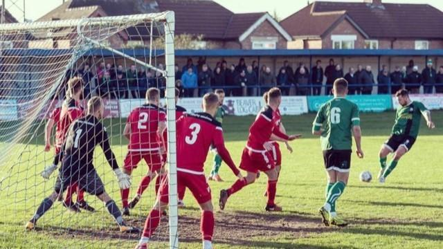Kyle Riley takes a free kick for 1874 Northwich. Picture: Ian Dutton