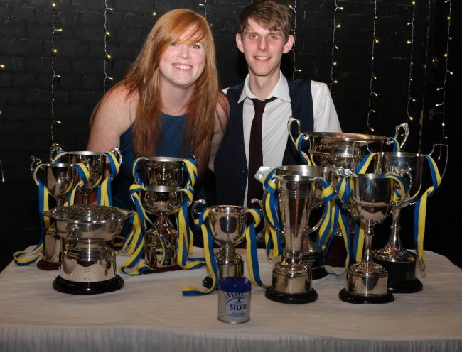 Emily Martin and Sam Taylor, with just some of their trophies from this year's Weaver Valley Cycling Club awards evening – as well as a tin of polish to keep them all nice and shiny. Picture: Ady Japp