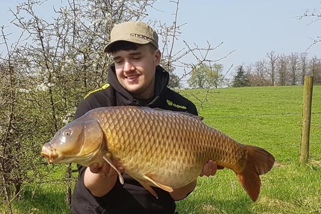 Keen angler Adam Noden with a 29lb common carp he caught in Middlewich the summer before his motorbike accident