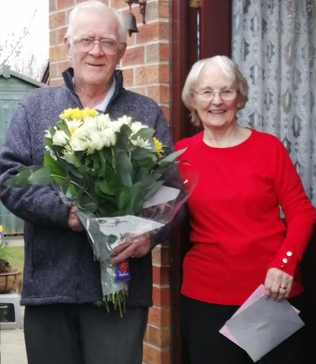 Harold and Lillian Waller celebrate their diamond wedding whilst on lockdown at home with flowers and an Indian takeaway