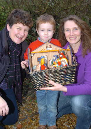 Karen Gay with Charlie Hext, four, and Kate Hext who looked after the village's nativity scene for the night