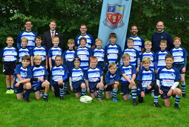 Winnington Park under 10s rugby union team with club chairman Paul Dean, coaches Neil Hollands and Sam Owen, as well as Chris Edwards from Redrow Homes, who bought new shirts for the squad to play in during the 2019-20 season.