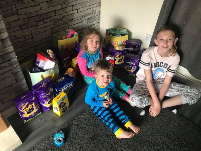 From left: Mia, Ellie and Harry Green with their Easter eggs from Cllr Treeby