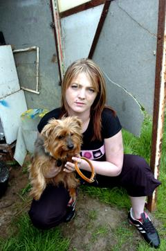 DEVASTATED: Melanie Heath, pictured with her pet Yorkshire terrier Lady, believes Jake was poisoned.