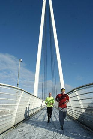 Runners over the M60 bridge