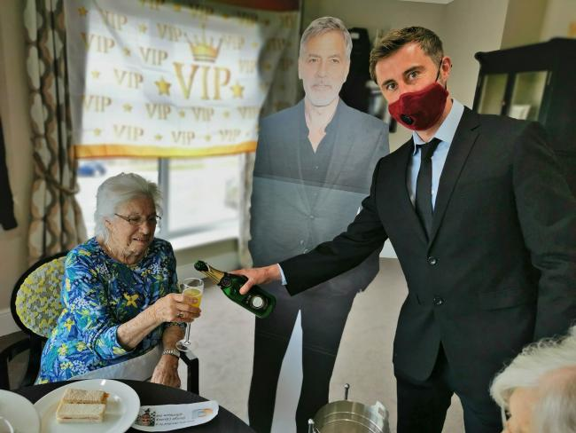 Lostock Lodge Care Home resident Joan Keyes enjoys her visit from Hollywood movie star George Clooney