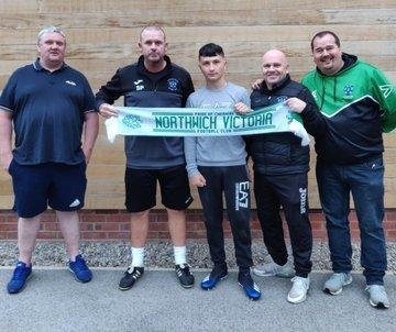 Northwich Victoria Juniors are celebrating. From left, Rob Walsh (Juniors chairman), Steve Pickup (NVFC assistant manager), Ryan Preston, Steve Wilkes (NVFC manager), Ian Egerton (Juniors secretary and NVFC vice chairman)