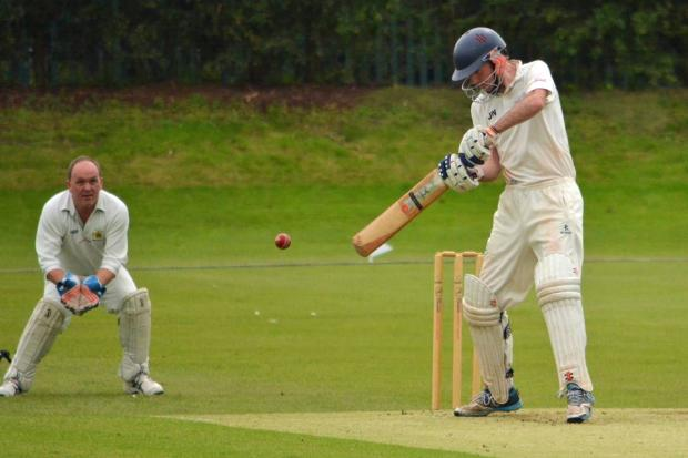 Jonny Wales helped steer Winnington to a big win against Northwich, as wicketkeeper Simon James watches closely