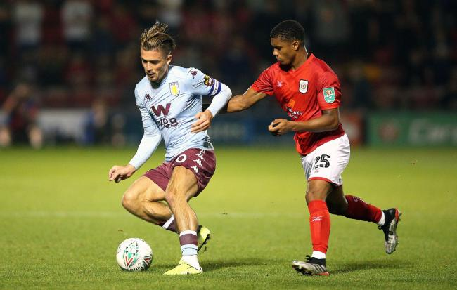 Rio Adebisi - seen here challenging Aston Villa captain Jack Grealish on his Crewe Alexandra debut - has penned a new two-year deal at Gresty Road. Picture by Nigel French/PA Wire