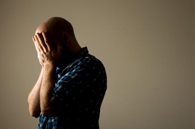 Men's mental health has suffered during the pandemic says a survey by Samaritans Cymru. Posed picture.