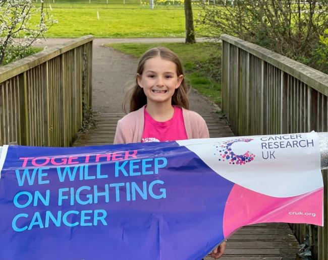 Charley Talbot-Butler, eight, completes 440,957 steps on her quest to 'help fund a cure for her daddy'