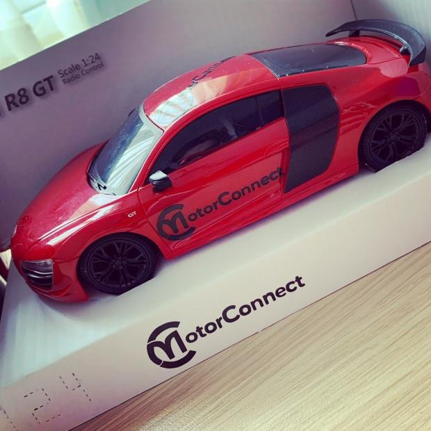 Northwich Guardian: One of the red Audi remote control cars that will appear in shop windows from April 12.