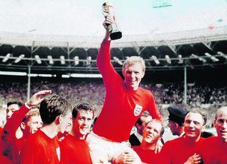 Northwich Guardian: Bobby Moore is carried by team members including Geoff Hurst, left