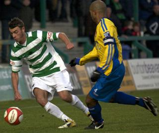 Northwich attacker Ryan Wade seeks a way past Staines skipper Danny Gordon. Picture: Paul Simpson