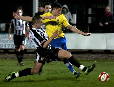 Wayne Riley is closed down by Stafford defender Luke George in Tuesday's 1-1 draw. Picture: Paul Simpson.