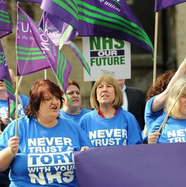 Northwich Guardian: Health workers demonstrate outside the Houses of Parliament against the Health and Social Care Bill
