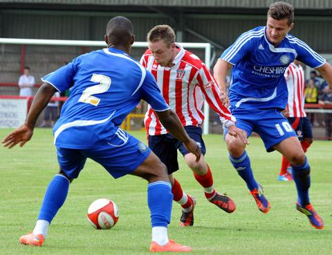 Joe Shaw in action during Witton's friendly draw with Macclesfield