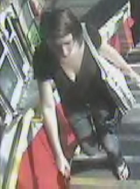 Police officers would like to speak to this woman after the dog attack on the train.
