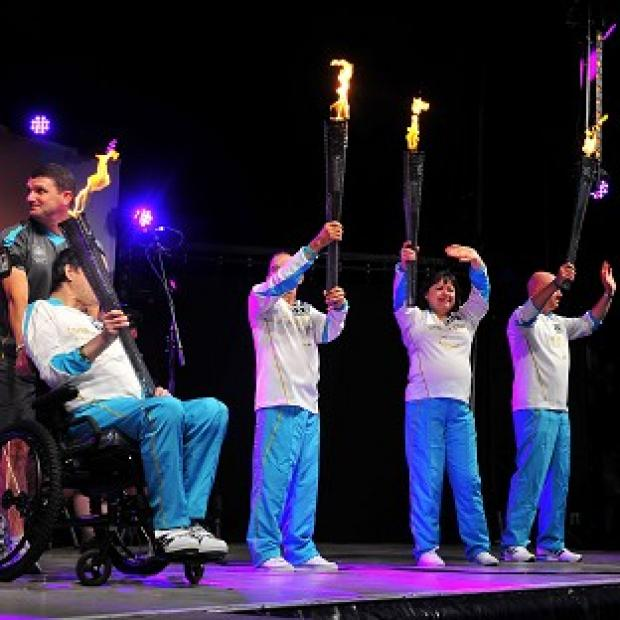Four specially-chosen torchbearers were given the honour of carrying the four flames into the stadium in Stoke Mandeville