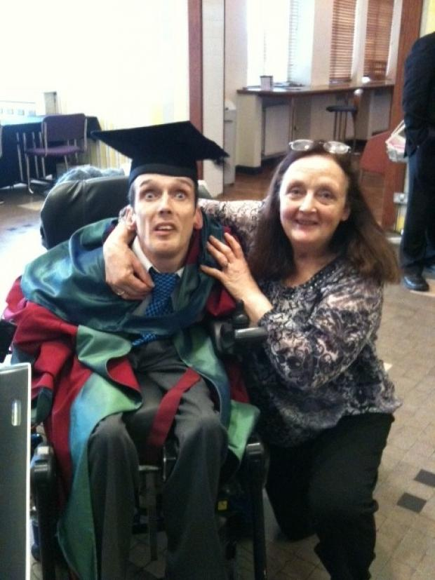 Northwich Guardian: Alexis with his mum, Thelma, at his graduation at Glyndwr University earlier this month.