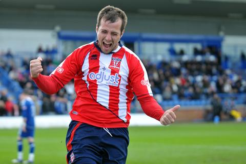 Ashley Stott celebrates scoring the opening goal in April's play-offs final win.