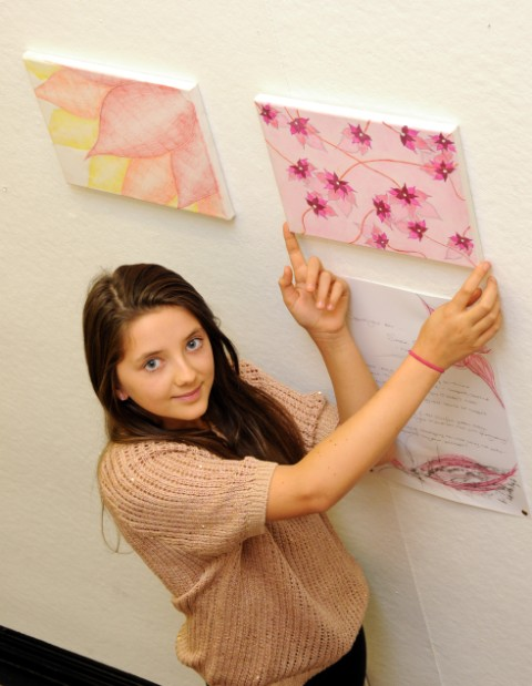 Sara Oswell, 13, with her work on display in the London Road Studios.