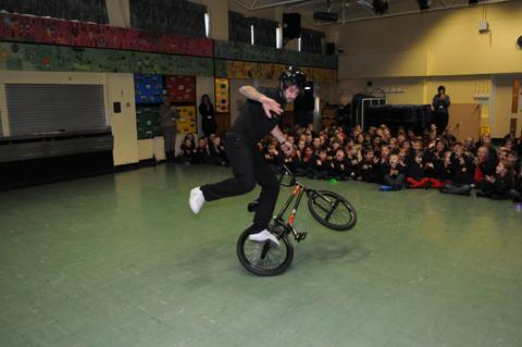 BMX champion Lee Musselwhite impresses children at Charles Darwin Primary School with his spinning and balancing tricks.